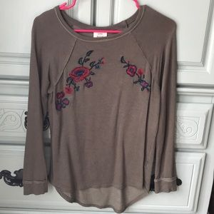 Green sweatshirt with floral embroidery detail